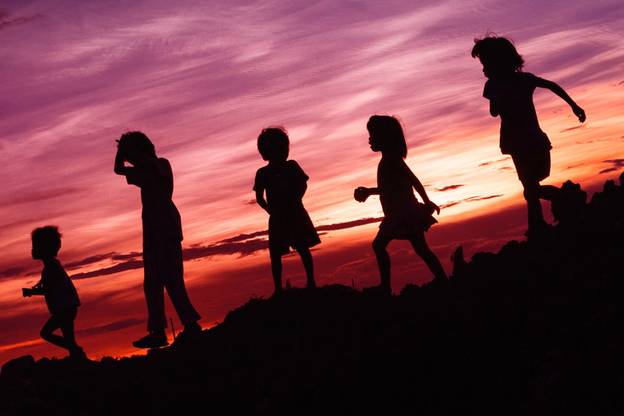Children playing at sunset Photo by Rene Bernal